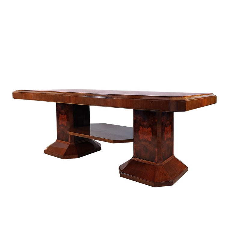 Large Art Deco meeting table, two column style stands connected with an horizontal strut, solid wood with walnut and burl walnut veneer, french polish. Can be dismantled.  Spain, Barcelona c. 1930.