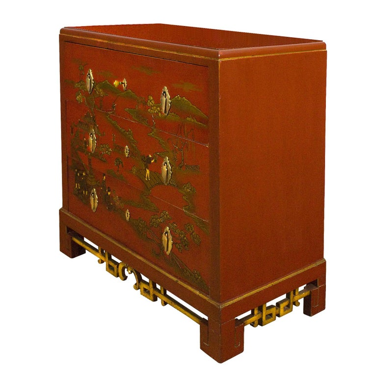 Japanese inspired chest of drawers-secrétaire, red lacquered solid wood with scenes in golden decoration and relief paints. Top drawer opens to a secretary with lemon wood and walnut burr, other drawers with bird's-eye maple inside. Polished solid