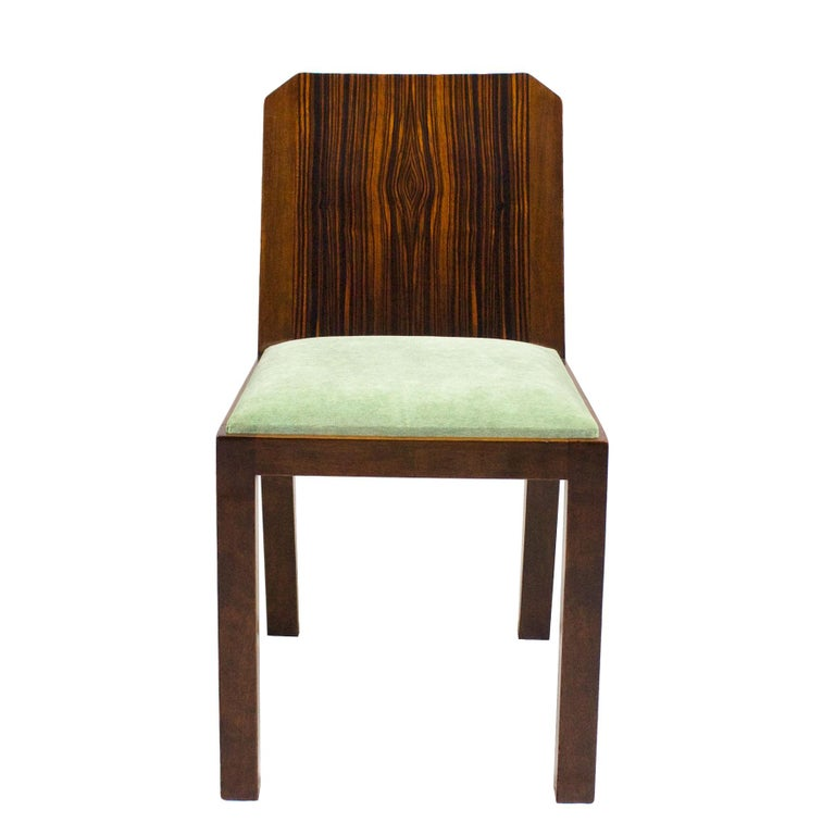 Set of six Art Deco chairs, solid walnut and Macassar ebony veneer, French polish. New seats with a celadon green velvet upholstery.  France, circa 1930.