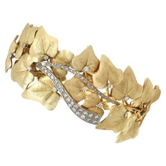 1930s 1.12 Carat Diamond Two-Color Gold Bangle Bracelet