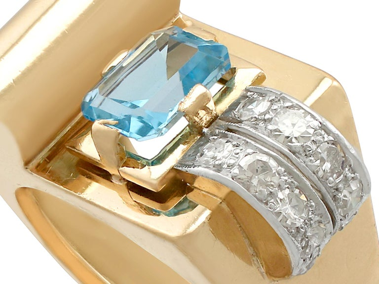 A stunning, fine and impressive antique 1.45 carat natural aquamarine and 0.30 carat diamond, 18 karat yellow gold, 18 karat white gold set dress ring in the Art Deco style; part of our antique jewelry/estate jewelry collections  This stunning