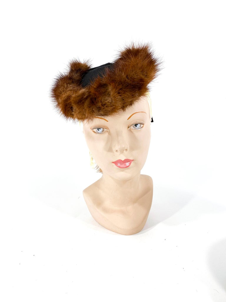 Late 1930s to early 1940s Black twill hat with brown mink trim and a wide grosgrain drape.