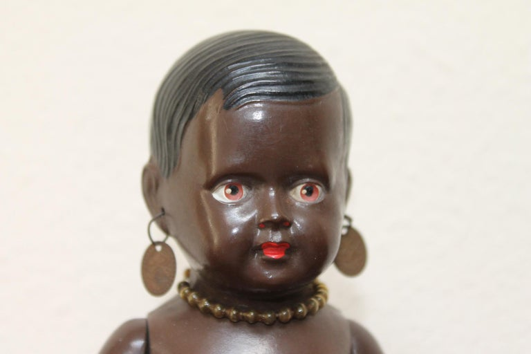 Cellba black sitting doll, Afro-American Celluloid doll -Cellba dolls Germany. 1930s Cellulloid - tortoise toy doll with movable arms and legs Marked: DRP Germany 18 1/2 She has red lips, red lipstick, original earrings, original necklace and