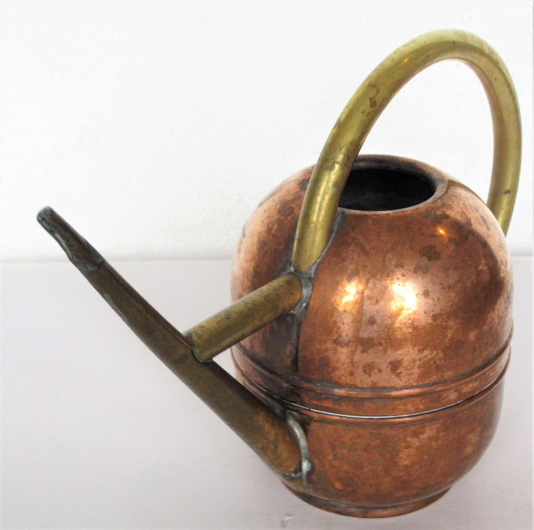 Iconic American Art Deco machine age copper and brass watering can designed by Walter Von Nessen for Chase. Stamped Chase with centaur figure on underside, circa 1930. Look at all pictures and read condition report in comment section.