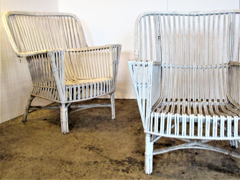 Three Classic American 1930s stick wicker armchairs in old worn white painted surface. Look at all pictures and read condition report in comment section.