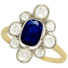 1930s Antique 1.70 Carat Sapphire and 2.10 Carat Diamond Gold Cluster Ring
