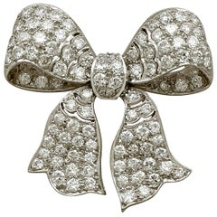 1930s Antique 2.85 Carat Diamond and Platinum Bow Brooch