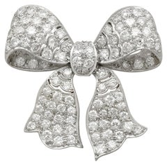 1930s Antique 2.85 Carat Diamond and Platinum Bow Brooch