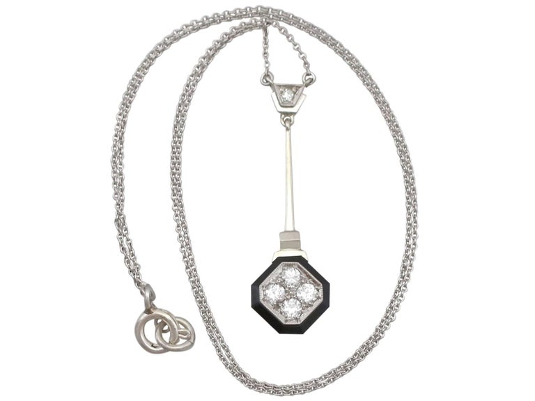 An impressive antique 1930's Art Deco 0.38 Ct diamond and black onyx, 14k white gold necklace; part of our diverse antique jewelery and estate jewelry collections.  This fine and impressive diamond and onyx necklace has been crafted in 14k white