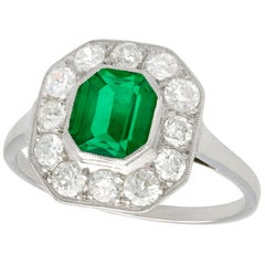 1930s Antique Emerald and Diamond White Gold Cluster Ring