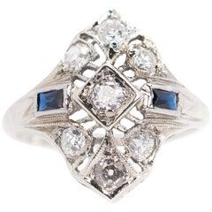 1930s Art Deco 0.25 Carat Diamond and Sapphire Platinum Engagement Ring