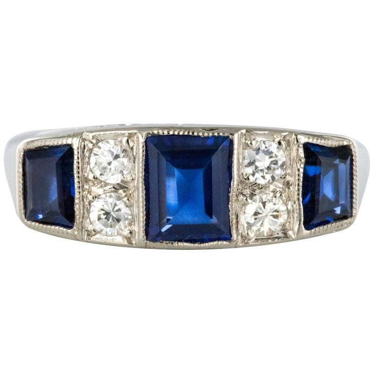 1930s Art Deco 1.69 Carat Sapphire Diamonds White Gold Garter Ring For Sale