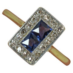 1930s Art Deco 18 Carat Gold French Cut Sapphire and Diamond Cluster Ring