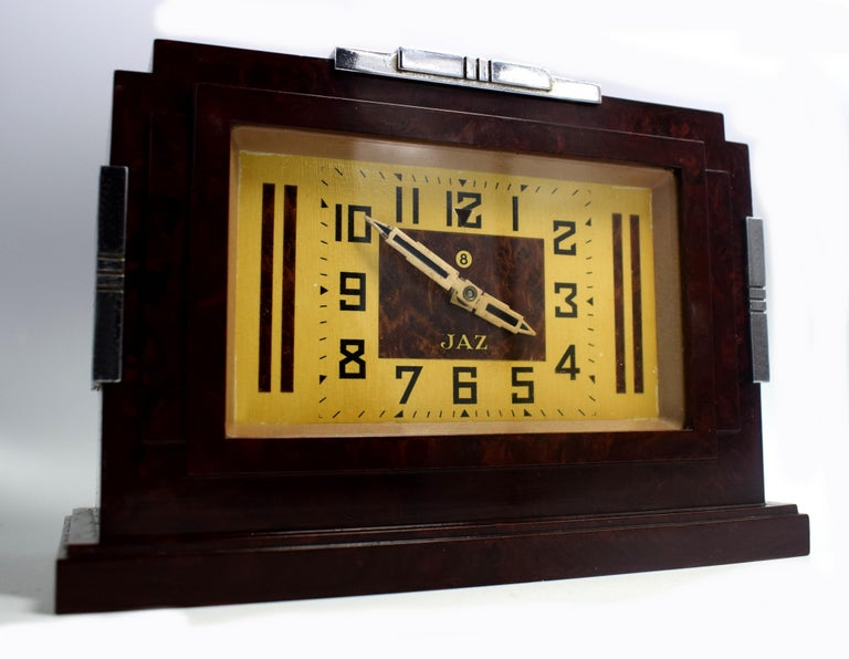 This is one of the daddies of JAZ Bakelite clocks 1930s . Made in France by the very collectable JAZ company, this clock screams everything about the Deco era we all love and admire, Industrial and modernist. The casing is a mottled deep red color,