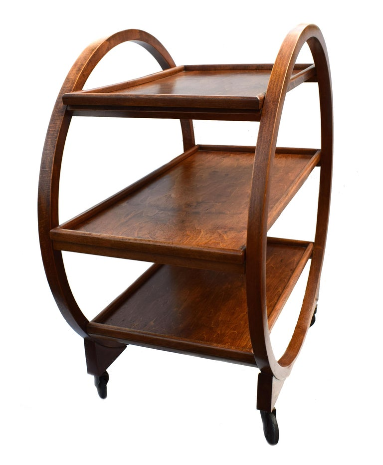 Very attractive and iconic English Art Deco Hostess trolley cart dating from the 1920s-1930s period. This three-tiered trolley not only looks awesome but is very functional too. Solid Oak in a mid-tone coloring. The condition is very good having