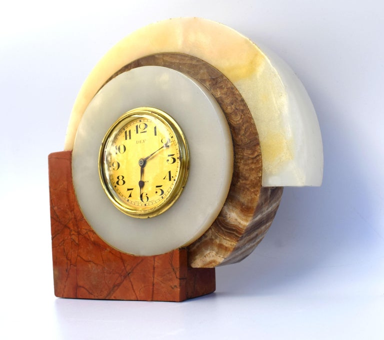 Very striking 1930s Art Deco French clock by Dep. The case is solid multicolored marble, the bezel and face are in gold tone metal. Very iconic Art Deco marble casing. This clock is a really good size and ideal as a desk clock or side table. All of