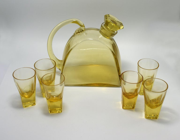 1930s Art Deco decanter set with tray. The tray this is a fabulous and original 1930s Art Deco drinks tray originating from France. Full gold tone metal stepped surround with wooden handles either side. Ideal size for use or display. These trays