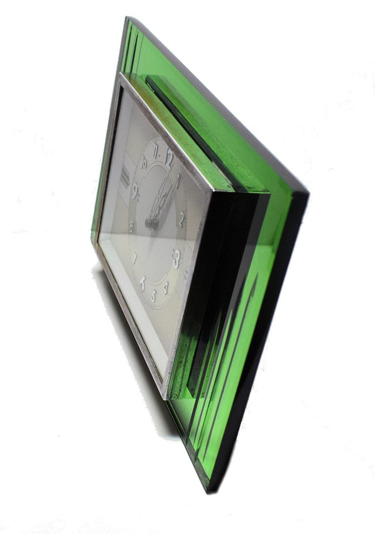 Everyone deserves a little glamour in their lives and what better way to indulge than this very stylish 1930s French green mirror clock which has an 8 Day movement. Ideal size for modern use, mantel or desk area. Has a metal easel to the back to