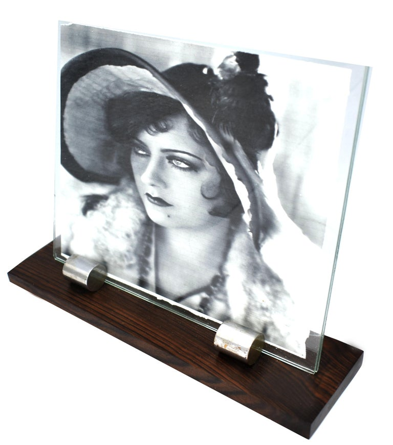 For your consideration is this large stylish 1930s Art Deco picture frame. Features a wooden base with two chrome accents which act as the glass holders. Lovely stylish piece, sourced in France and dating to the 1930s. The photo image inside the