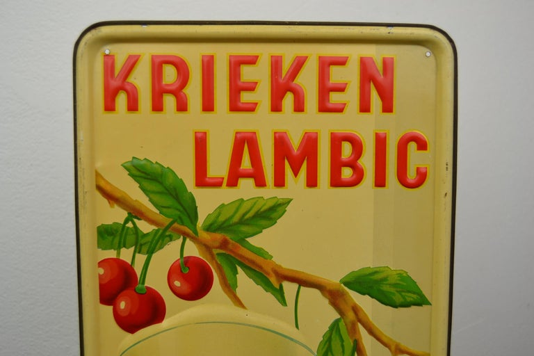 1930s tin advertising sign for Belgian beer, cherry beer Lambic. This tin publicity sign for brewery dry- pikkel (1904-1955) dates from 1937 And was made by Jofico Brussels. The bright red color of the cherries and the glass filled with cherry