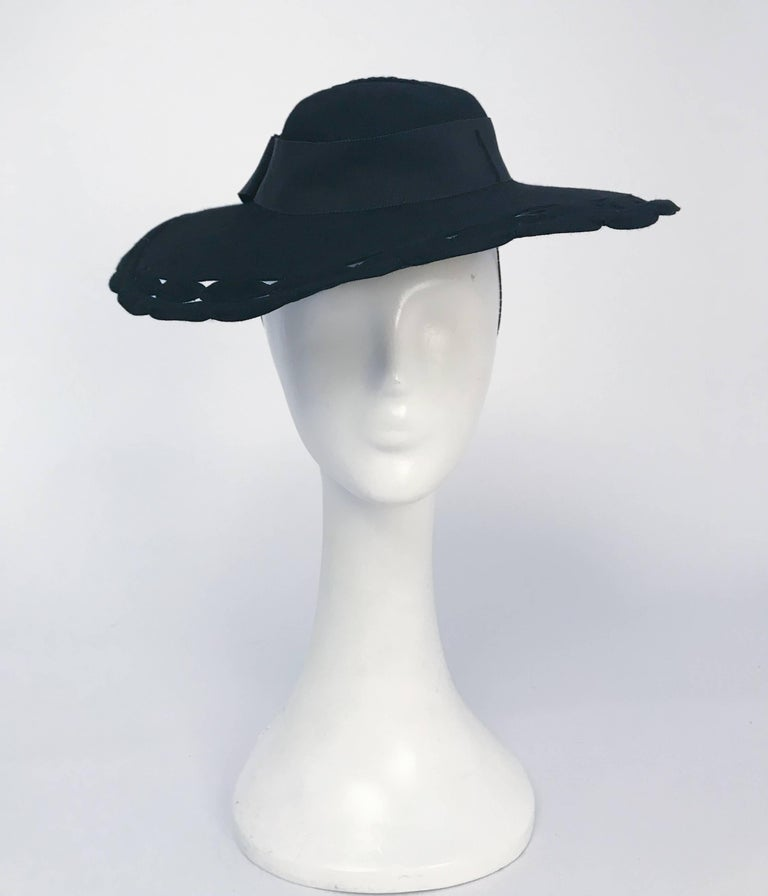 1930s Black Wide Brim Hat w/ Scalloped Brim & Cutouts. Held to head w/ elastic band and inner comb.