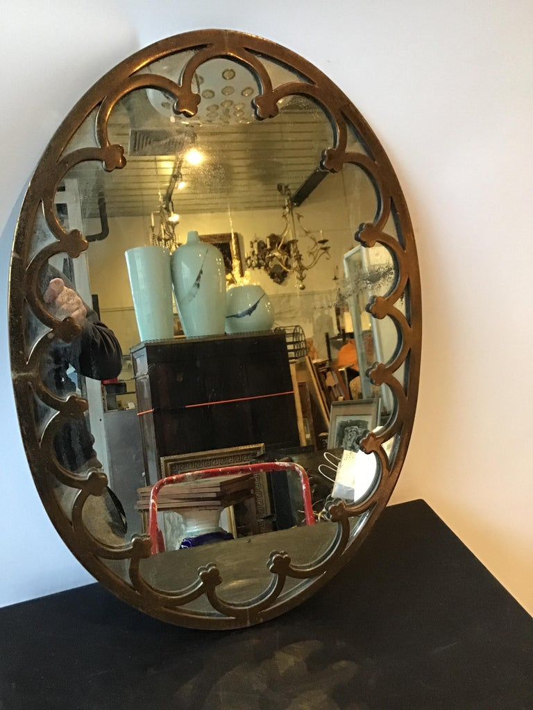 1930s brass oval mirror. This mirror can be shipped through UPS.