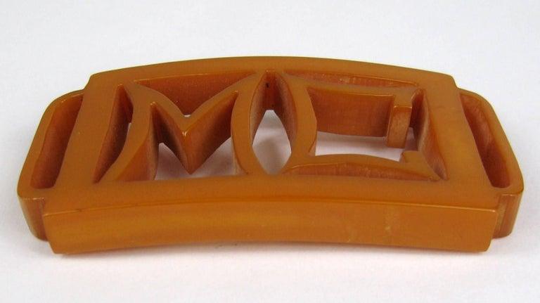 Stunning early Bakelite / Catalin Belt Buckle, Hand Carved. Initials are M C. This is a true piece of bakelite circa 1930's. It measures 3.65 inches x 2 inches. This is out of a massive collection of Hopi, Zuni, Navajo, Southwestern, sterling