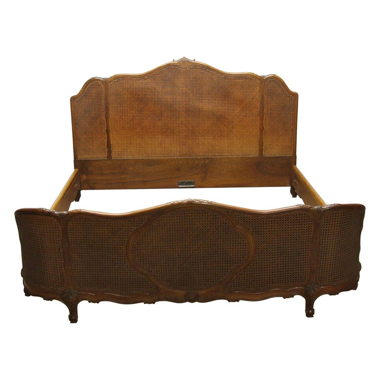 1930s Carved Dark Tone Walnut and Cane Art Deco King Size Bed Wood Frame For Sale