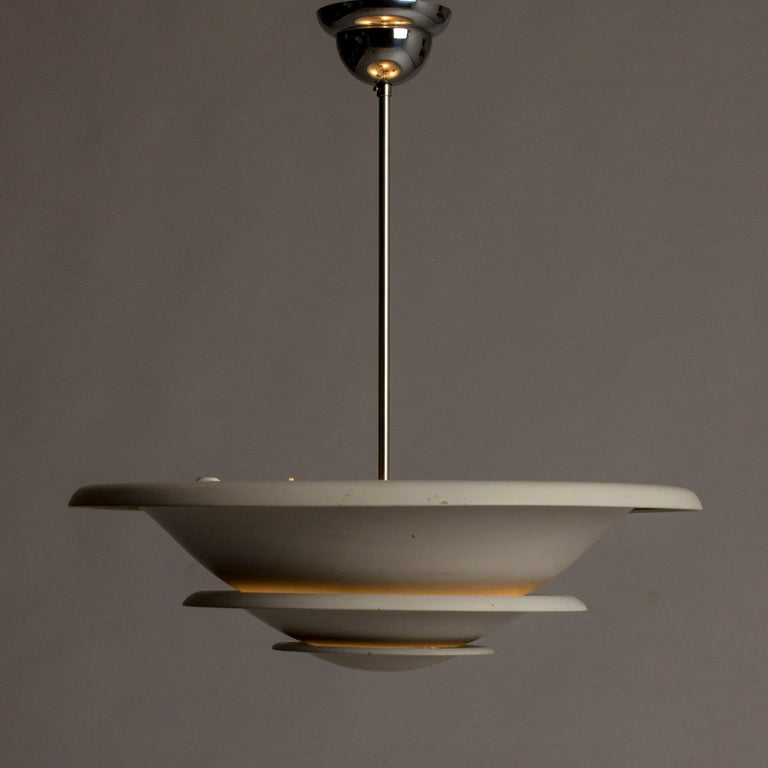 Elegant ceiling lamp from Bröderna Malmström, made in the 1930s. Made in sections that let light out softly between them and towards the ceiling.