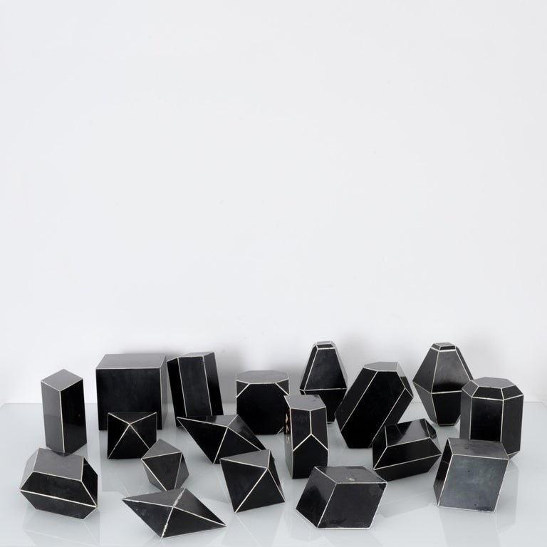 Crystal models from Czechia, circa 1930, made from Bakelite, an early synthetic plastic. Originally used in science classrooms, each depicts a different crystal structure. The bakelite is a deep black color; the edges of the shapes are delineated