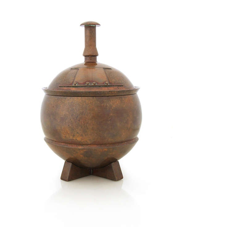 An Arts & Crafts heavy lidded urn of solid bronze.