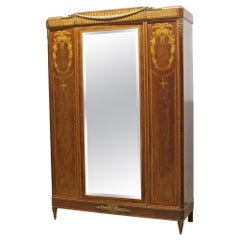 1930s French Art Deco Carved Walnut Mirrored Armoire with Detailed Inlays