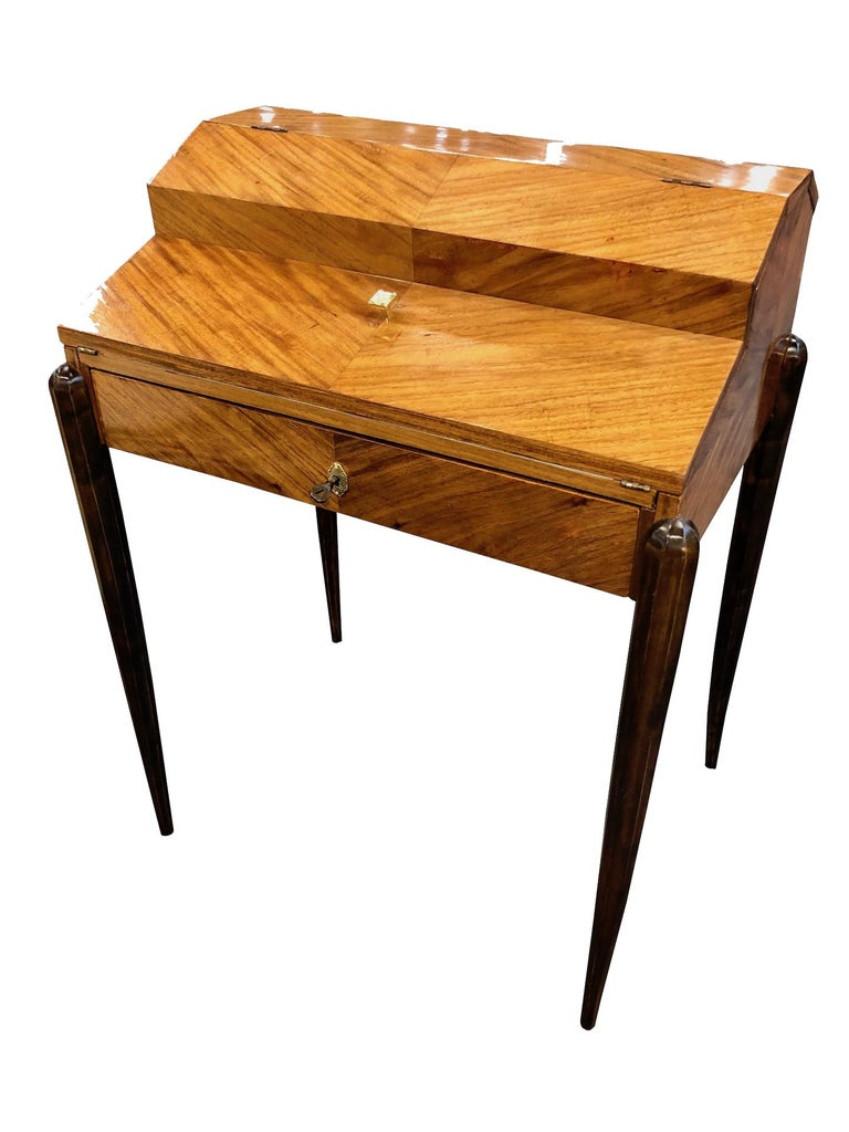 Very clear light design. Davenport in real wood veneer. The thin table legs give this furniture its lightness. One big drawer with key lock outside and three little drawers inside the bureau. When the big drawer is opened it is holding the