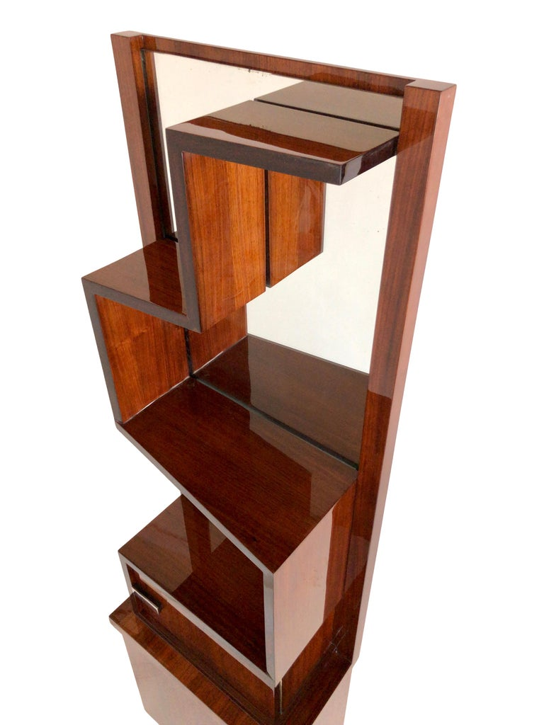 Asymmetric shelf in real wood veneer.  Fresh restoration with high gloss polyester lacquer.  Heightened with a new base.  Original mirror with signs of age.   Measurements:  Width 50 cm  Height 166 cm Depth 29 cm.