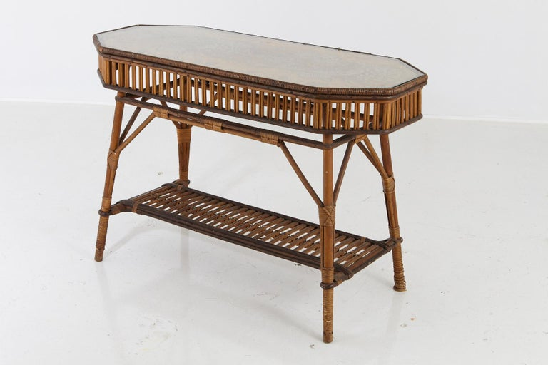 1930s French octagonal bamboo and wicker console table with glass top and a second tier.