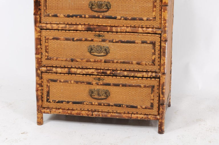 A French bamboo and wicker four-drawer commode from the first half of the 20th century, with swivel mirror in the upper section. This 1930s piece stopped us in our tracks. We love the functionality of a commode with the timeless elegance of bamboo