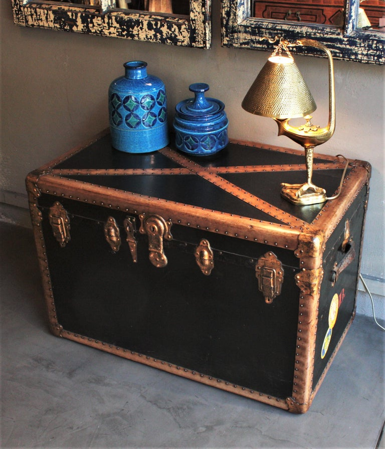 Beautiful black canvas steamer trunk with beige trims and leather handles, France, 1930s. Wooden steamer trunk covered with black canvas. It has gilt Iron locks and hardware and iron studs. Its interior still has got its original paper