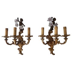 1930s French Cast Bronze Cherub Bows and Porcelain Roses Sconces