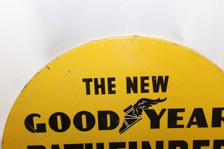 Advertising its high quality and low price is this wonderful Goodyear Tires sign. Normally these signs were found in the middle of a Pathfinder Tire that would be on display. In great condition considering its age and being a harder to find sign.