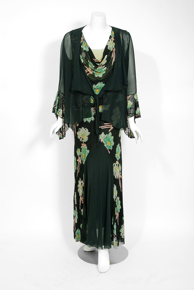 The breathtaking large-scale green black floral garden deco print used on this 1930's lace and silk-chiffon gown ensemble has a timeless allure that I find irresistible. The bodice is a low plunge cowl-neck sleeveless. The elegant blousy waist falls