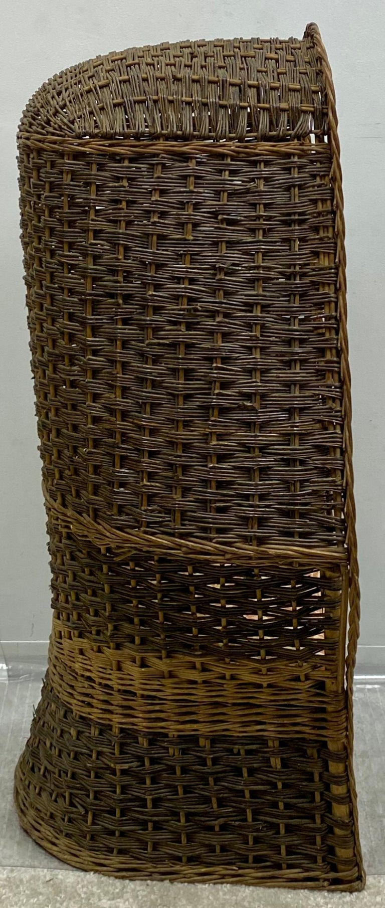 This is a 1930s hand woven wicker porter's chair. It is a two tone weave and is in very good condition. An unusual find!