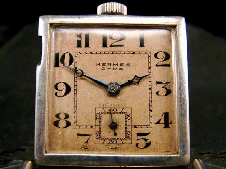 Rare Hermes belt buckle watch from the 1930s. Silver case with Arabic numerals and smaller inset second clock. Made for golfers so that they could look down and check the time without wearing a watch. Looks great closed and then flips open. Made in
