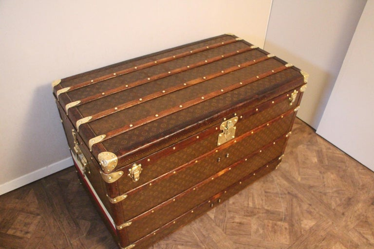 Exceptional and rare Louis Vuitton high steamer trunk featuring stencilled canvas, all leather trim, solid brass Louis Vuitton stamped clasps and lock, solid brass corners and solid brass LV stamped side handles. Painted stripes on the sides. Very
