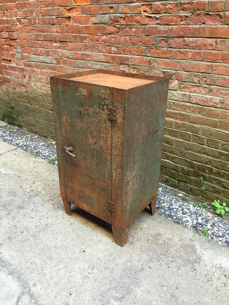 Locking industrial cabinet that is aged to perfection. Overall rust and green chipped paint. Spectacular twist handle, circa 1930-1940.