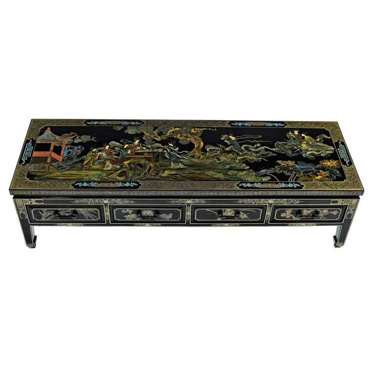 This incomparable chinoiserie coffee table sets the standard for this style. Timeless perfection. Just as fashionable now as they day it was made. We procured this from the son of the original owner. The hand painted motif can only be described as