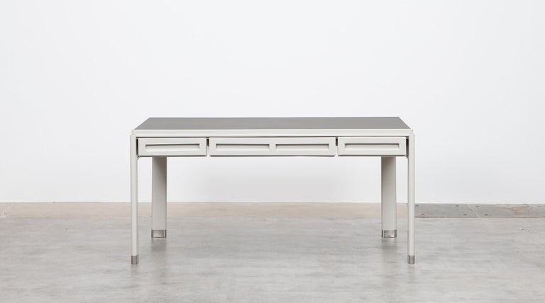 Very rare and attractive desk designed by famous Jean Prouvé in 1934. The desk comes on a steel frame and contains three drawers in two different sizes. The tabletop is linoleum. Manufactured by Atelier Jean Prouvé.  As much as the Bauhaus