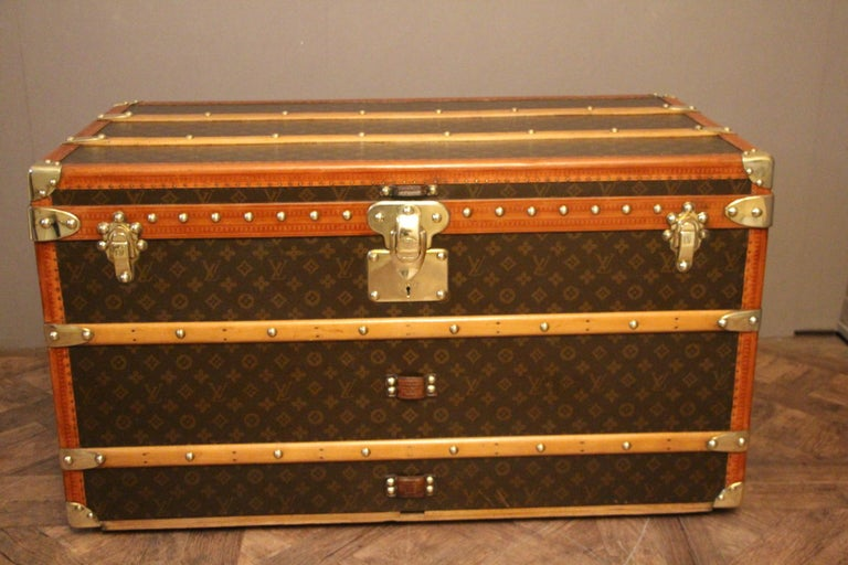 This superb Louis Vuitton steamer trunk features stenciled monogram canvas, lozine trim, LV stamped solid brass locks and studs as well as leather side handles and brass corners. It has got a beautiful original patina and is very