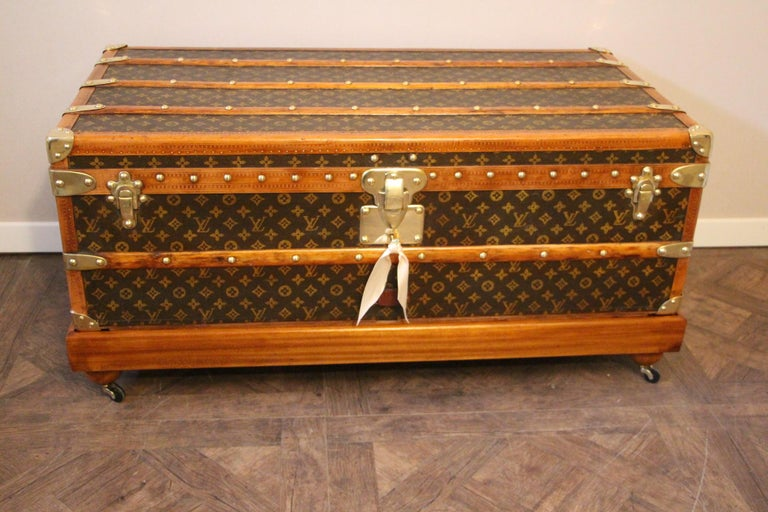 Very nice Louis Vuitton hand stenciled monogram canvas featuring honey color lozine trim and LV stamped solid brass locks and clasps, LV stamped studs as well as large leather side handles. No painted stripes, no initials. Interior is all original