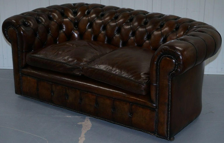 We are delighted to offer for sale this exceptionally rare original 1930s cigar brown leather Chesterfield club sofa in newly restored condition with feather filled cushions.  A really very rare find, you almost never come across early 20th