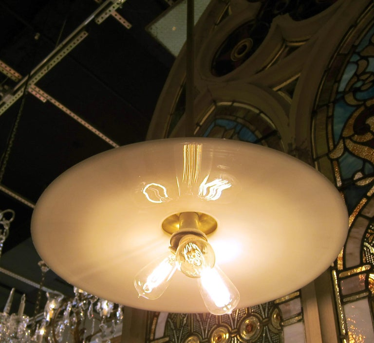American 1930s Milk Glass Industrial Brass Benjamin Saucer Pendant Light with 3 Lights For Sale